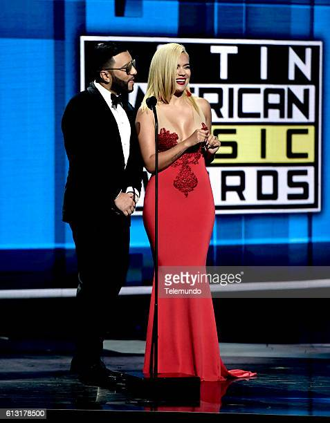 AWARDS 'Show' Pictured Recording artists Alex Sensation and Karol G speak on stage during the 2016 Latin American Music Awards at the Dolby Theater...