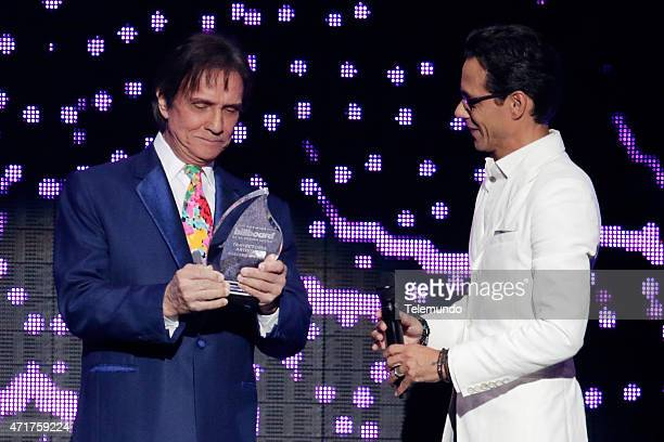 Roberto Carlos and Marc Anthony on stage during the 2015 Billboard Latin Music Awards from Miami Florida at the BankUnited Center University of Miami...