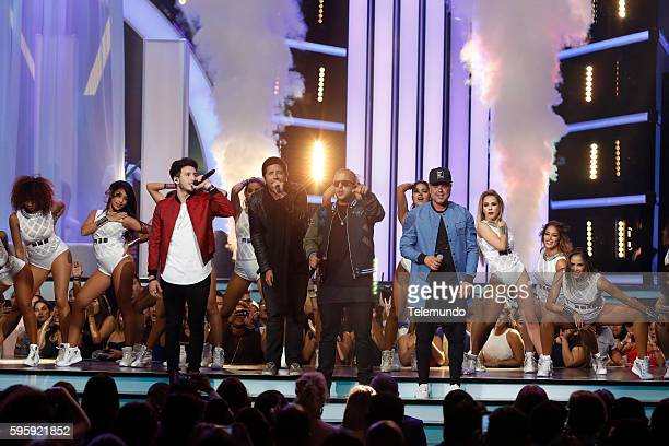 MUNDO 2016 'Show' Pictured Sebastian Yatra Cali y El Dandee and Juan Magan perform on stage during the 2016 Premios Tu Mundo at the American Airlines...