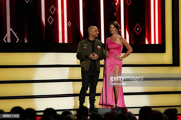 MUNDO 2016 Show Pictured Sie7e and Carolina Miranda on stage during the 2016 Premios Tu Mundo at the American Airlines Arena in Miami Florida on...
