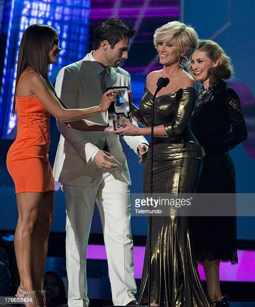 Winner Christian Bach with Presenters Rafael Amaya Aracely Arambula on stage during the 2013 Premios Tu Mundo from the American Airlines Arena in...