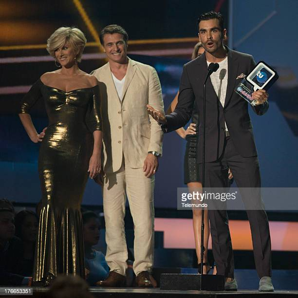 Winner Gonzalo Garcia and Presenters Christian Bach Juan Soler on stage during the 2013 Premios Tu Mundo from the American Airlines Arena in Miami...
