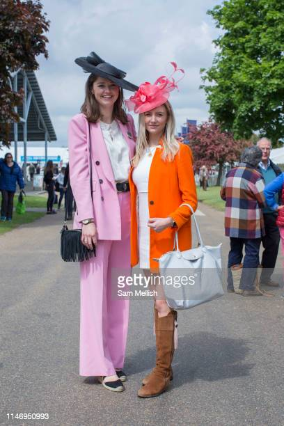 Show stewards Sophie Baker and Hetty Gittas dressed in brightly coloured outfits at the annual Suffolk Show on the 29th May 2019 in Ipswich in the...
