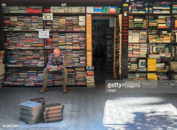 showcase of an antiquarian bookstore in alsancak, izmir, turkey - book store stock photos and pictures