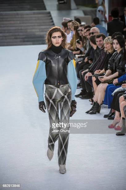 XXX showcases the design on runway during the Louis Vuitton Resort 2018 show at the Miho Museum on May 14 2017 in Koka Japan