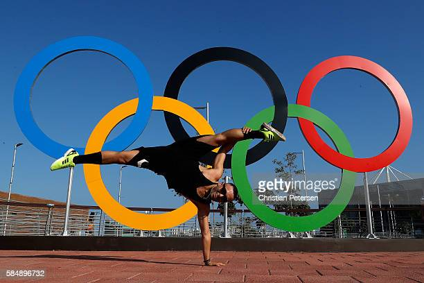 Showcaster performers from Bradesco pose in front of the Olympic rings ahead of the 2016 Summer Olympic Games on July 31 2016 in Rio de Janeiro Brazil