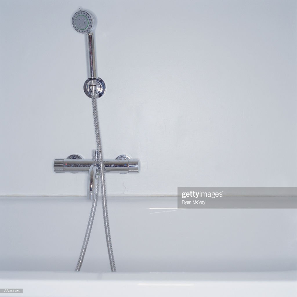shower head in bathtub ストックフォト getty images