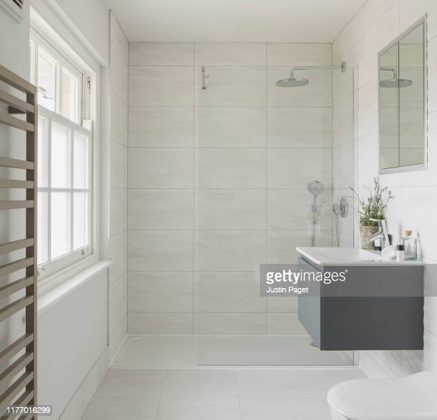 shower room in luxury uk house - domestic bathroom stock pictures, royalty-free photos & images