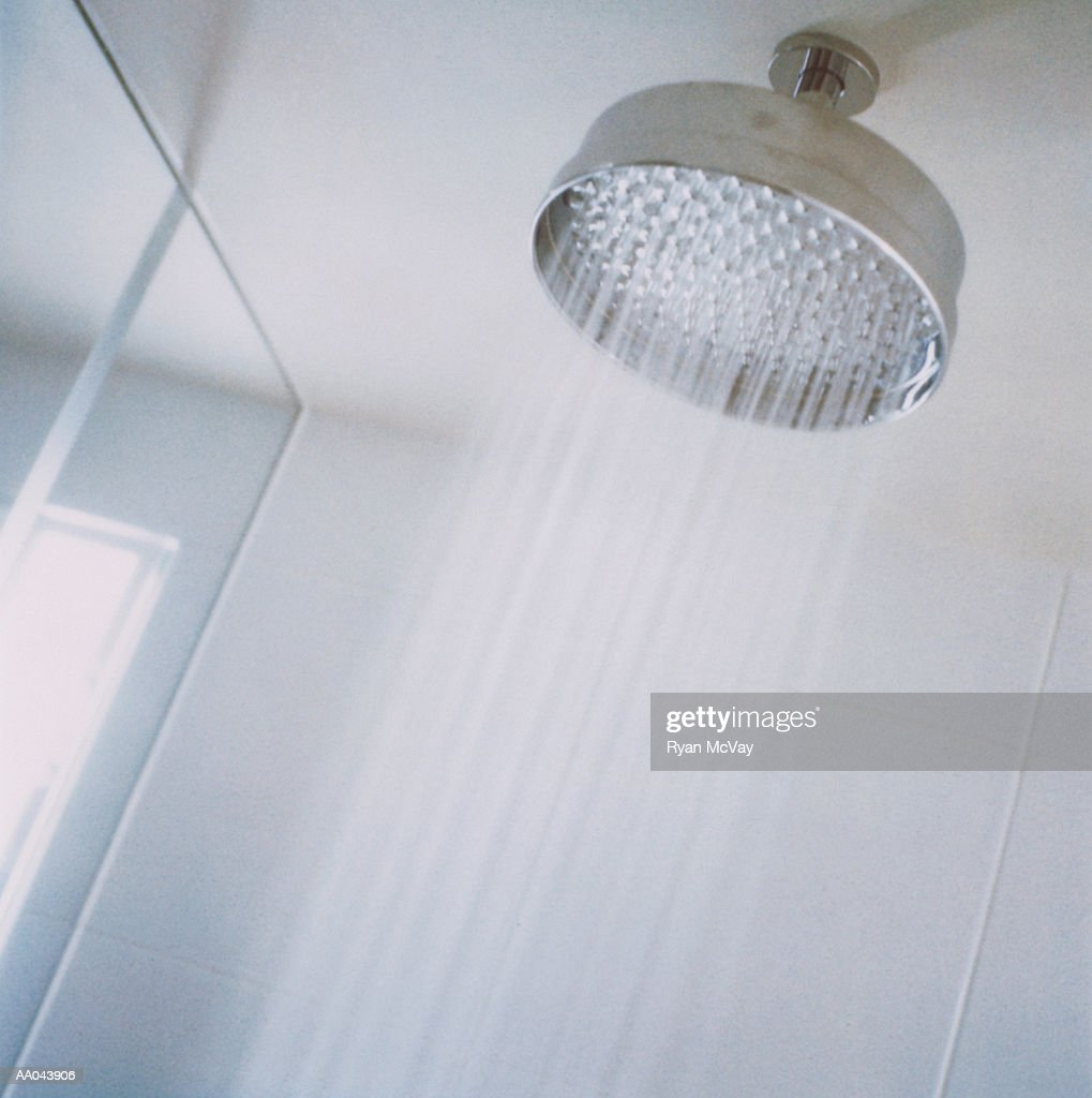 showerhead with running water low angle view stock photo getty images