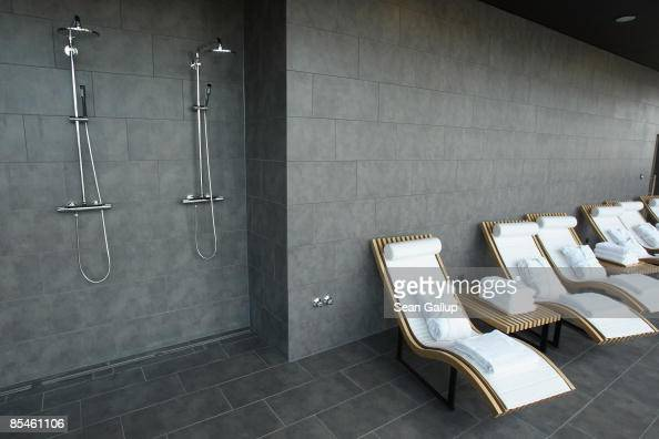 Outstanding Showers And Lounge Chairs Await Guests In The Sauna Area At Machost Co Dining Chair Design Ideas Machostcouk