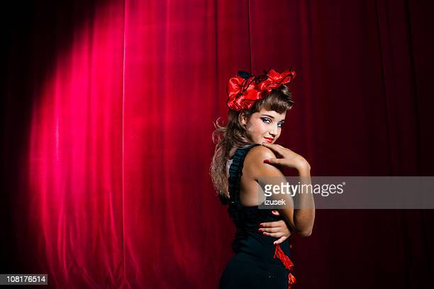 showgirl acting coy on stage - cabaret stock pictures, royalty-free photos & images