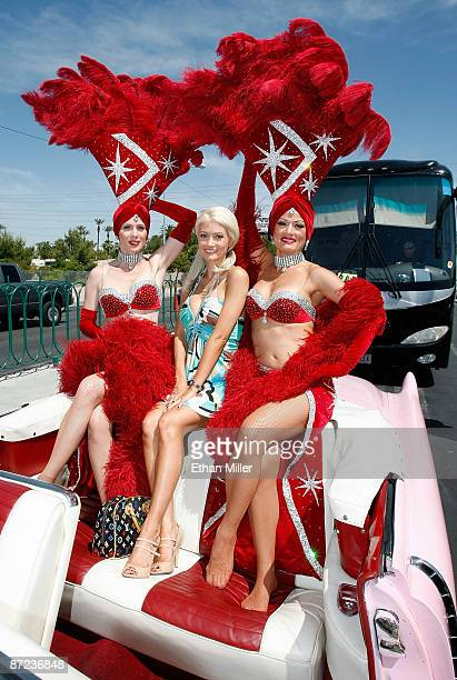 Showgirl JP Howard model and television personality Holly Madison and showgirl Stacey Shea pose in a pink Cadillac after Las Vegas Mayor Oscar...