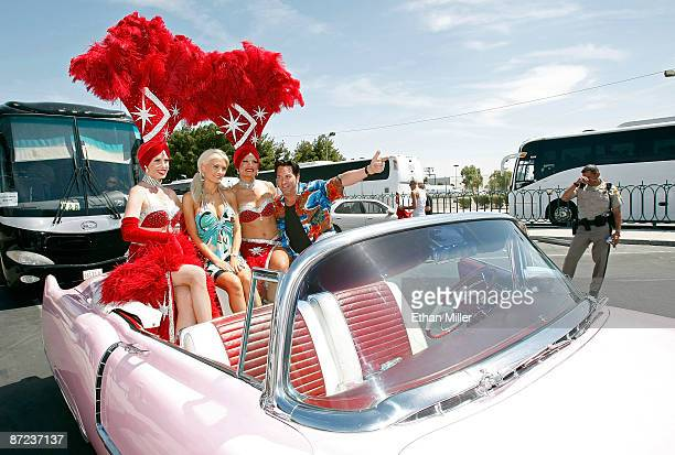 Showgirl JP Howard model and television personality Holly Madison showgirl Stacey Shea and Elvis Presley impersonator Jesse Garon pose in a pink...