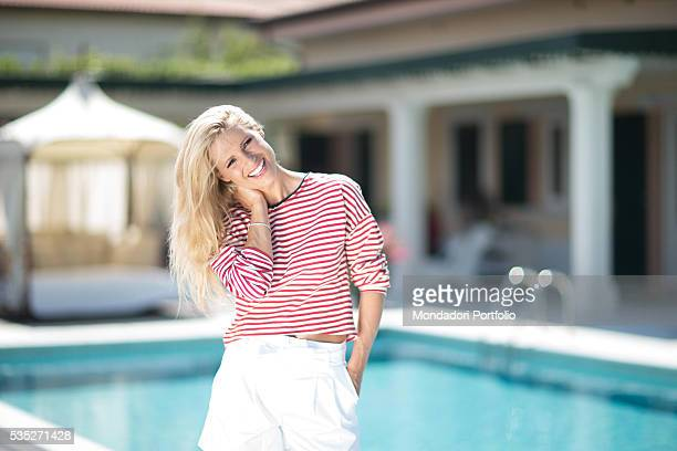 Showgirl Michelle Hunziker in the garden of her mansion on the sea Forte dei Marmi Italy 23rd June 2015