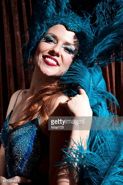 showgirl on stage curtain in background. - actor stockfoto's en -beelden