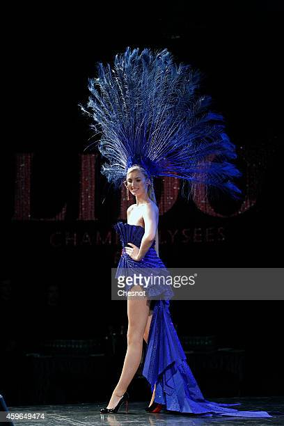 A showgirl presents the fashion design during a press conference to announce the new show directed By Franco Dragone and scheduled for Spring 2015 at...