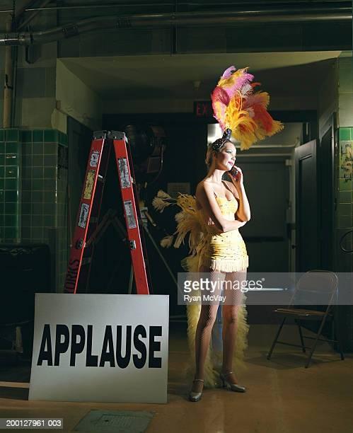 Showgirl talking on mobile phone backstage
