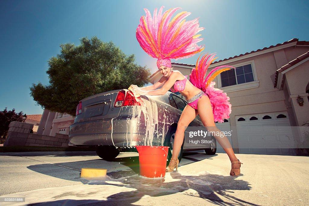 Showgirl washing car : Stock Photo