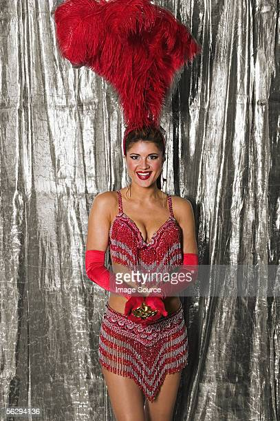 Showgirl with handful of coins