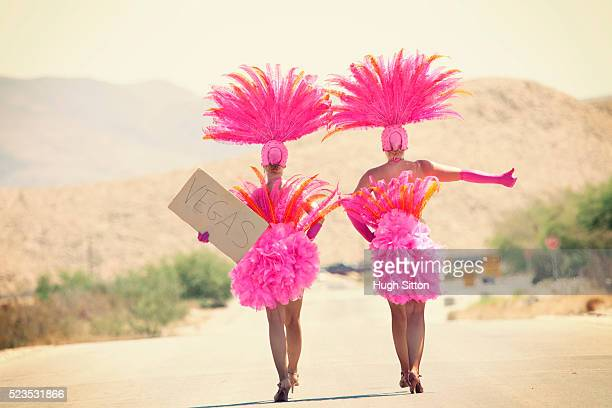 showgirls hitchhiking - hugh sitton stock pictures, royalty-free photos & images