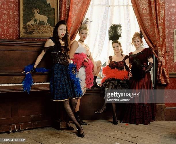 showgirls in saloon - boa stock pictures, royalty-free photos & images