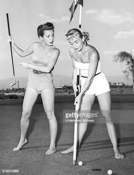 Showgirls Joy Skylar and Florence Walters get some unusual practice in for the special showgirl golf tournament to be held at the Desert Inn Country...