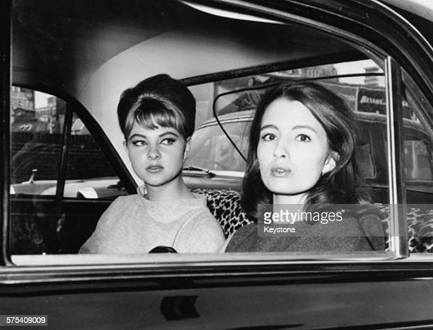 Showgirls Mandy RiceDavies and Christine Keeler witnesses in the Profumo Scandal pictured in the back of a car as they leave court following the...