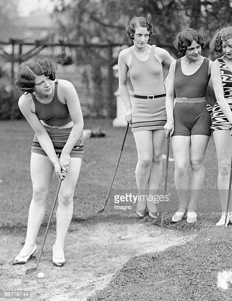 Showgirls playing golf Girls of the Wake up and Dream Revue playing golf while wearing their bathing suits Photograph 31st of May 1929 Maidenhead...