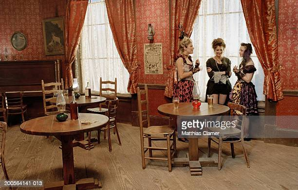 Showgirls talking at saloon