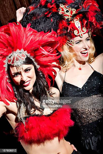 Showgirls Waving to Audience After Stage Performance
