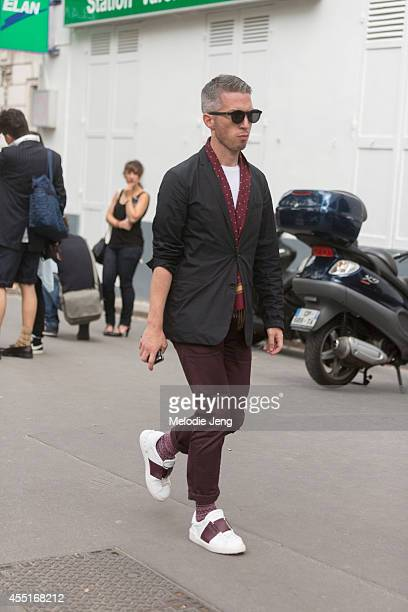 A showgoer exits Dior on Day 2 of Paris Haute Couture Fashion Week Autumn/Winter 2014 on on July 7 2014 in Paris France