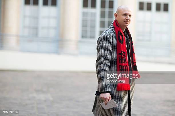 f5e7810d4 A showgoer wears a Gosha Rubchinskiy red and black Chinese logo scarf over a  black and