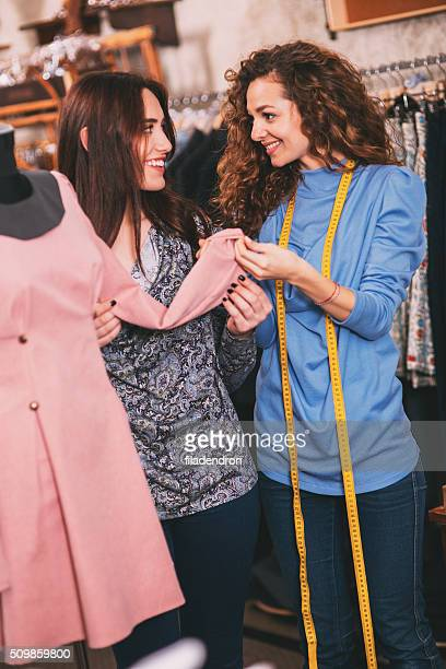 Showing a dress to a customer