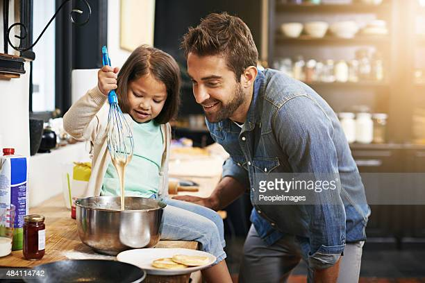 Showing dad a thing or two about cooking