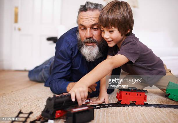 Showing grandpa my new train set
