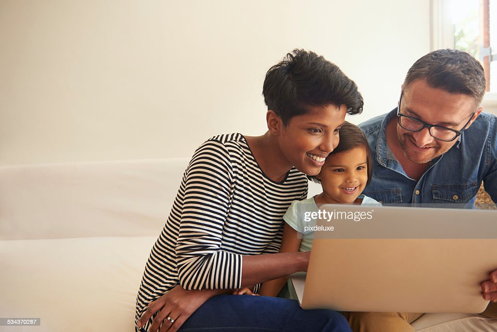 Showing her daughter the world...wide web : Stock Photo