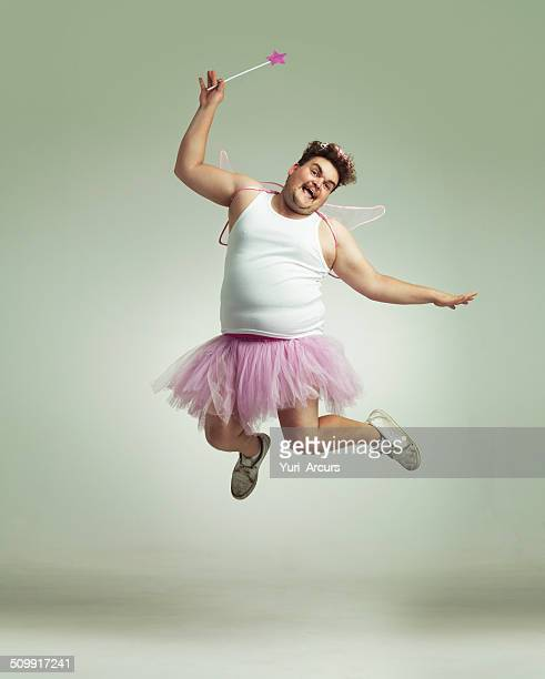 showing his lighter side! - pink dress stock photos and pictures
