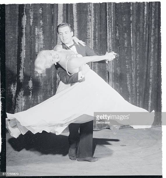 Showing off her Terpsichorean talents to the best advantage screen star Ginger Rogers glides through an intricate dance routine during a nightclub...