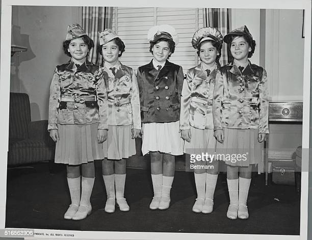 Showing Off The Quints Winter Wardrobe The patriotic note is added to the winter wardbrode of the Dionne Quintuplets by uniforms patterned after...