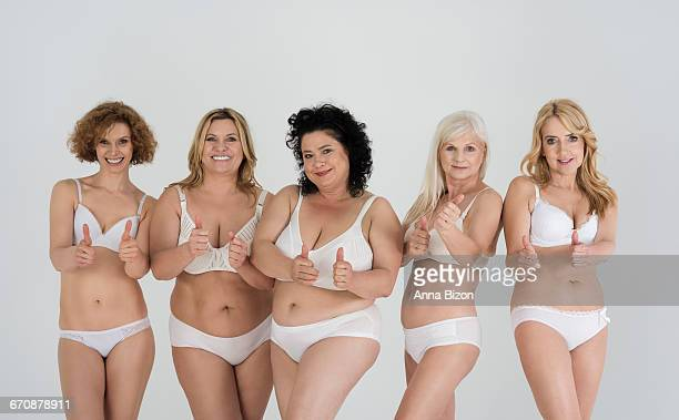 Showing ok sign by women in underwear. Debica, Poland