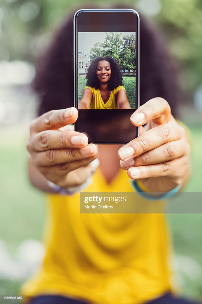 Showing selfie to the camera : Stockfoto