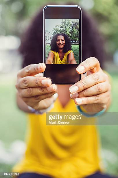 Showing selfie to the camera