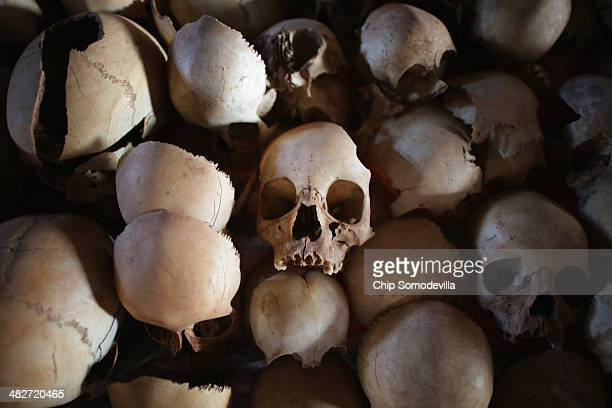Showing signs of extreme trauma victims' skulls are displayed on metal racks inside the Ntarama Catholic Church genocide memorial ahead of the 20th...