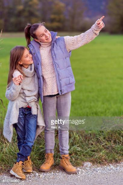 showing something in the distance - lane sisters stock photos and pictures