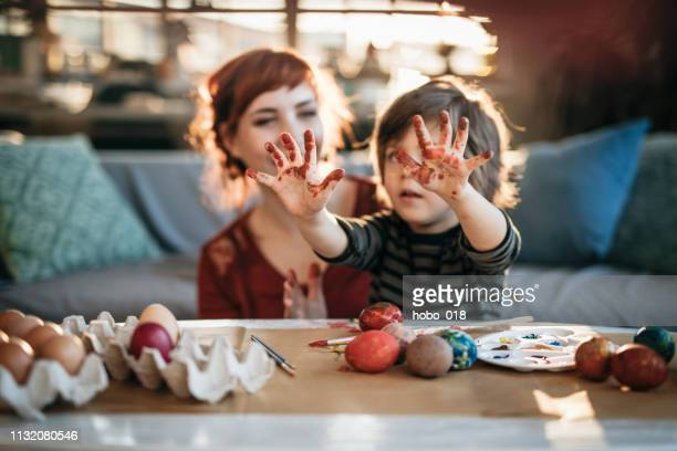 showing the hands of artist - dirty easter stock pictures, royalty-free photos & images