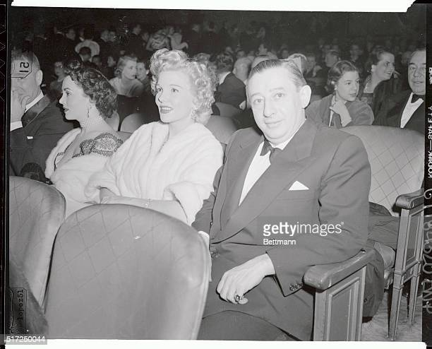 Showman Billy Rose and beautiful Joyce Matthews exwife of Milton Berle are shown as they made their public appearance tonight at the Ziegfield...