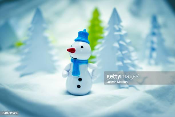 Showman toy between paper fir trees