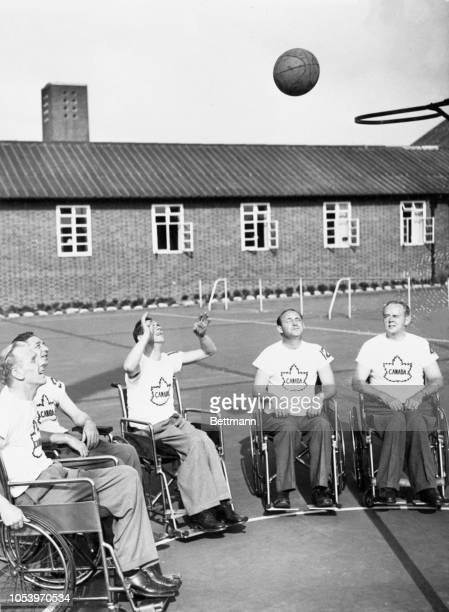 Shown at practice are the members of the Canadian Basketball team which is taking part in the Paraplegics' Olympics at Stoke Mandeville from left are...