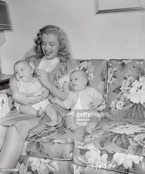 "Shown ""brushing up on her home work"" is cute 18-year-old Marilyn Monroe. Marilyn is a former ""baby sitter"" who got the break of her life through that..."