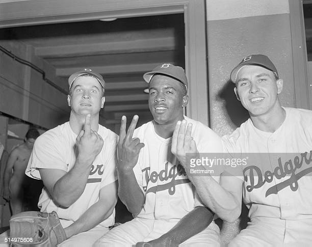 Shown in this photo taken after the Brooklyn Dodgers' 52 victory over the Boston Braves at Ebbets Field today are the three players who combined to...